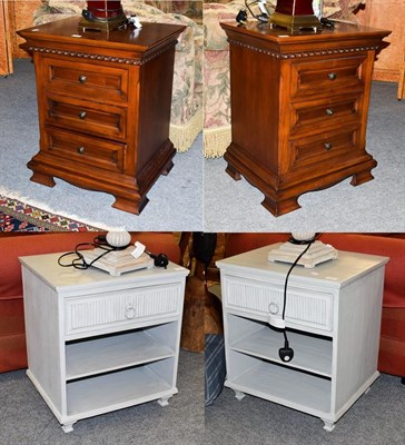 Lot 1067 - A pair of three drawer bedside chests, raised on bracket feet, 58cm by 46cm, 72.5cm high,...