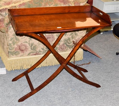 Lot 1068 - A butlers tray table on folding stand