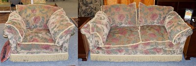 Lot 1069 - A chenille upholstered two-seater settee with bolster cushions and in stylized floral design, 193cm