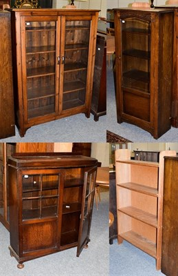 Lot 1076 - A pine glazed bookcase, 100cm by 31cm by 140cm high together with two similar 1940's oak...
