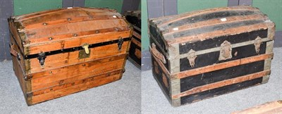 Lot 1087 - Two 19th century wood and metal bound dome-top steamer trunks, largest 84cm by 48cm by 60cm...