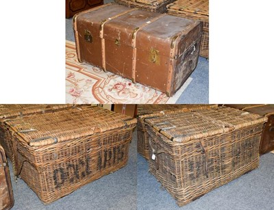 Lot 1088 - A pair of wicker metal bound baskets with rope carry handles, 91cm by 55cm by 48cm high;...