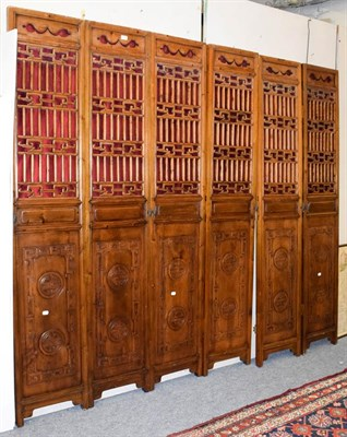 Lot 1089 - Six Chinese carved wood doors/panels, each 210cm by 39cm (6)