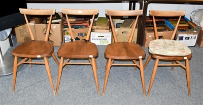 Lot 1095 - A set of four Ercol elm and beech stacking chairs, stamped, seat height 44cm