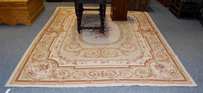 Lot 1097 - A modern needlepoint carpet of Aubusson design, the field of scrolling acanthus vines with oval...