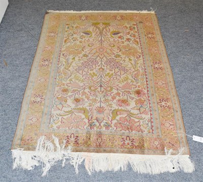 Lot 1099 - Indian prayer rug, the cream field with Tree of Life, surrounded by birds enclosed by...
