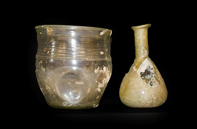 Lot 1 - A Roman Glass Beaker, probably 4th century AD, with slightly everted rim and band of three...