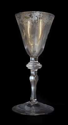 Lot 2 - A Light Baluster Wine Glass, circa 1740, the rounded funnel bowl engraved with a border of...