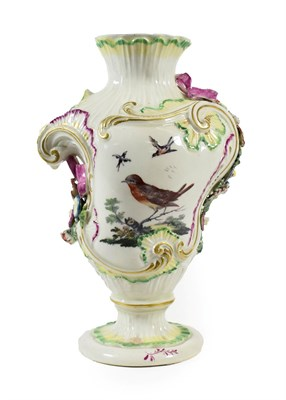 Lot 7 - A Derby Porcelain Rococo Scroll Vase, circa 1765, of asymmetric baluster form, painted with...