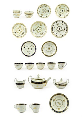 Lot 13 - A Flight Worcester Porcelain Part Tea Service, circa 1785, of fluted form, painted in...
