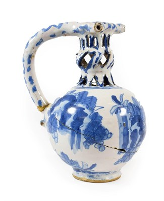 Lot 14 - A Dated English Delft Puzzle Jug, London or Brislington, 1670, of ovoid form, the knopped...