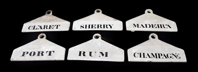 Lot 24 - ~ Six Creamware Bin Labels, 19th century, inscribed in black RUM, SHERRY, MADEIRA, CHAMPAGNE,...