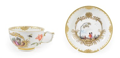 Lot 48 - A Meissen Porcelain Teacup and Saucer, circa 1740, painted with figures in landscape within...