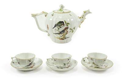 Lot 49 - A Meissen Porcelain Tea Service, circa 1750, painted with birds in branches and with scattered...