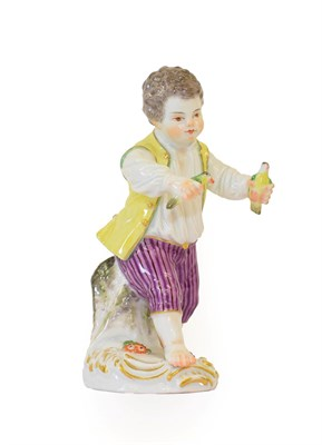 Lot 51 - A Meissen Porcelain Figure of a Boy, late 19th/early 20th century, wearing 18th century costume...