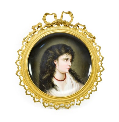 Lot 57 - A Vienna Style Porcelain Saucer Dish, circa 1900, painted with a bust portrait of a girl,...