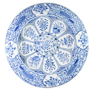 Lot 69 - A Chinese Porcelain Large Circular Dish, Kangxi, painted in underglaze blue with a foliate...