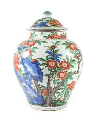 Lot 77 - A Chinese Wucai Porcelain Jar and Cover, mid 17th century, of baluster form, painted with birds and
