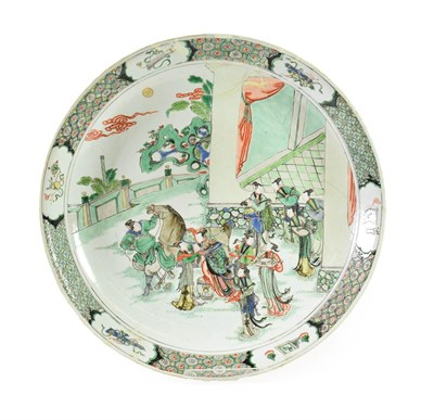 Lot 79 - A Chinese Porcelain Dish, Kangxi, painted in famille verte enamels with a lady mounting a horse and