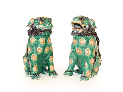 Lot 85 - A Pair of Chinese Porcelain Temple Guardians, in 18th century style, modelled as seated lion...