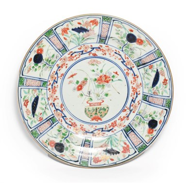 Lot 89 - An Arita Porcelain Dish, circa 1700, painted in colours in Kraak style with a central jardiniere of