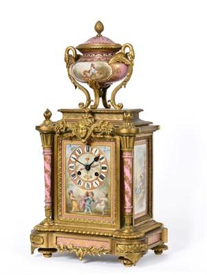 Lot 404 - A Gilt Metal Pink Porcelain Mounted Striking Mantel Clock, circa 1890, surmounted by a swan handled