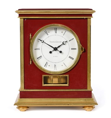 Lot 405 - A Brass and Red Lacquered Atmos Clock, signed Jaeger LeCoultre, model: Embassy, 20th century,...