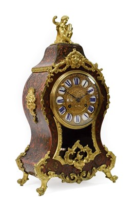 Lot 407 - <> A Tortoiseshell and Brass Inlaid Striking Mantel Clock, retailed by LeRoy A Paris, circa...