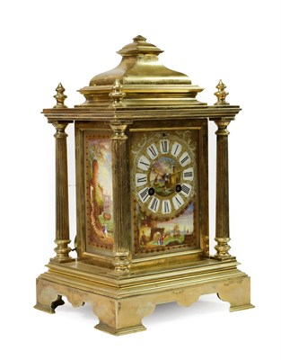 Lot 408 - <> A Brass and Porcelain Mounted Striking Mantel Clock, circa 1890, caddy pediment with four turned