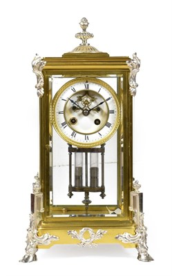 Lot 409 - <> A Brass Four Glass Striking Mantel Clock, circa 1900, brass case with silvered mounts, four...