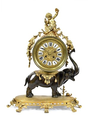 Lot 411 - An Ormolu and Bronze Striking Elephant Mantel Clock, circa 1890, surmounted by a cherub, bronze...