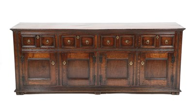 Lot 433 - David Semple: A Reproduction Oak Sideboard, in 17th century style, the moulded top above four...
