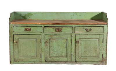 Lot 437 - A George III Green-Painted Pine Dresser, late 18th century, the three-quarter gallery above a...