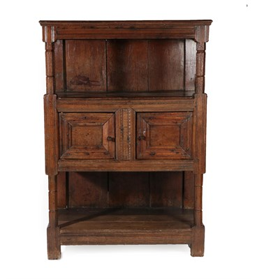 Lot 438 - A Joined Oak Standing Livery Cupboard, early 18th century, the moulded top above chamfered and...
