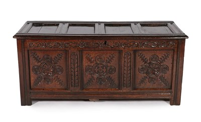 Lot 440 - A Late 17th Century Joined Oak Chest, the hinged lid with four moulded panels above a carved frieze