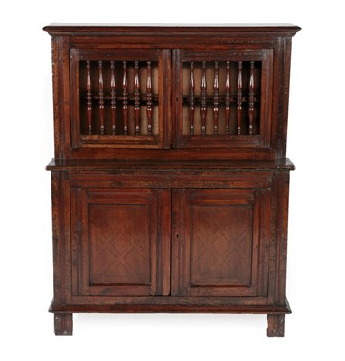 Lot 441 - An 18th Century Joined Oak Food Cupboard, probably North Wales, the upper section with turned...