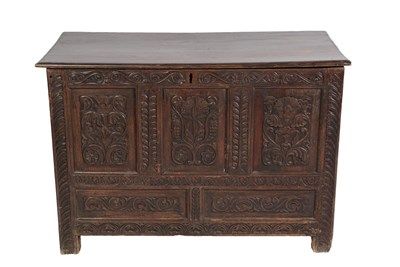 Lot 448 - A Joined Oak Chest, the later hinged lid above five carved panels all between carved stiles and...