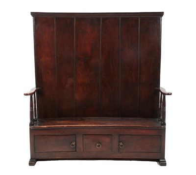 Lot 453 - A 20th Century Joined Oak Settle, of boarded construction, the curved back section above a...