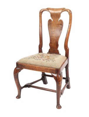 Lot 457 - A George I Oak Dining Chair, early 18th century, with solid yoke splat above a drop-in floral seat
