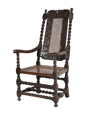 Lot 458 - ^ A Late 17th Century Carved Walnut Open Armchair, with cane back and seat, the carved top rail...