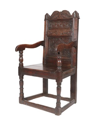 Lot 461 - A Late 17th Century Joined Oak Wainscot Armchair, with a leaf carved top rail above moulded...