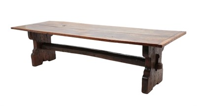 Lot 466 - An Oak Trestle Dining Table, the top of two plank construction with cleated ends, on X form...