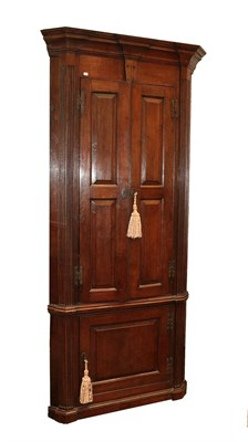 Lot 468A - An 18th Century Style Oak Free-Standing Corner Cupboard, the breakfront moulded cornice above...
