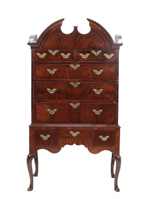 Lot 484 - A Walnut and Featherbanded Chest on Stand, the moulded cornice above two short and three long...