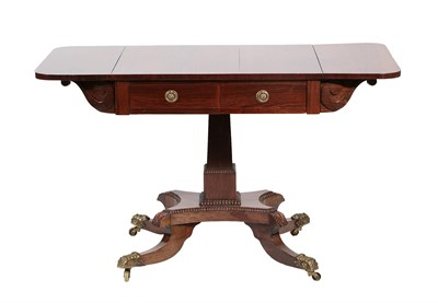Lot 492 - <> A Regency Rosewood Sofa Table, early 19th century, with two rounded drop leaves above two...