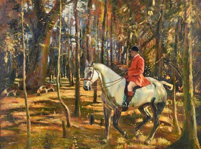 Lot 1042 - Arthur Spooner (1873-1962) Huntsman and hounds on the scent in Autumnal woodland  Signed, oil...