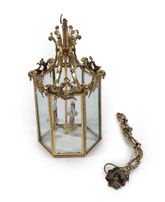 Lot 8 - A Late Victorian Brass Lantern of Hexagonal Form, the central plain shaft issuing three...