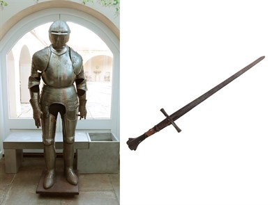 Lot 36 - A Victorian Steel Suit of Armour, in the late 15th century style, with rolled and gadrooned...