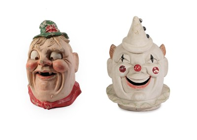 Lot 42 - Two Continental Papier-Mache Parade Masks, circa 1940, one modelled as a grinning Pierrot...