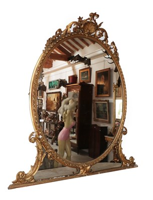 Lot 58 - A Large Louis XVI Style Giltwood and Gesso Overmantel Mirror, 19th century, the oval mirror...